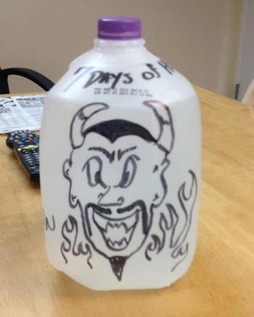 Daddy's Little Ghoul takes her 'hell jug' to work. The other EMTs and firefighters had some fun with it to support her.