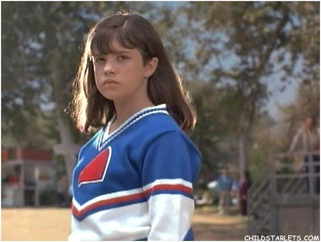 She almost gives up football glory... all for Junior (Devon Sawa).