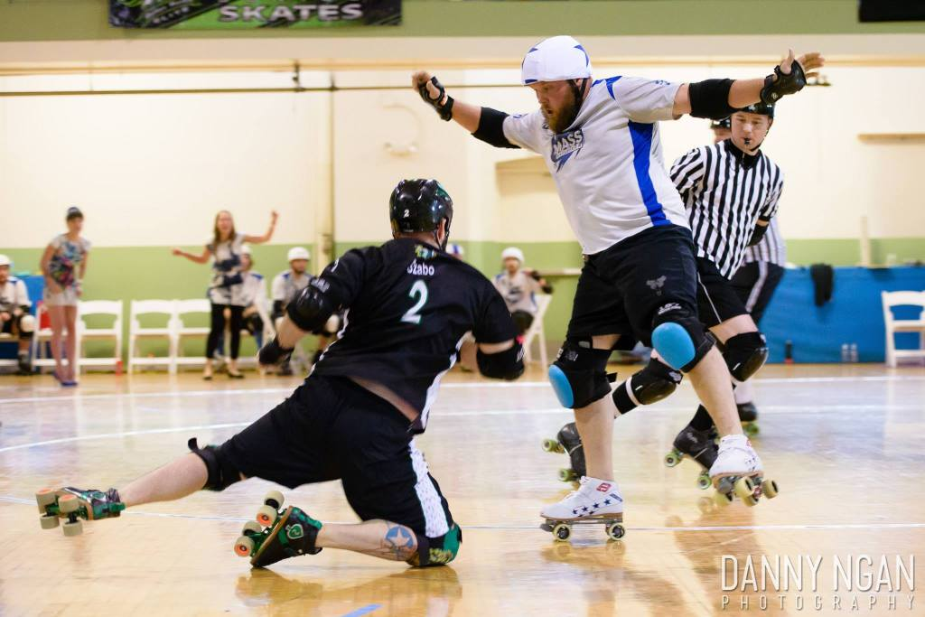 Mass Maelstrom and New York Shock Exchange are known for their rivalry on the east coast. As two of the oldest men's teams they have seen the changes of derby - and they still play just as hard and fast as ever. (Bill Coulter dances around Chris Szabo in the first round of the MRDA Championships 2014). Photo by Danny Ngan Photography